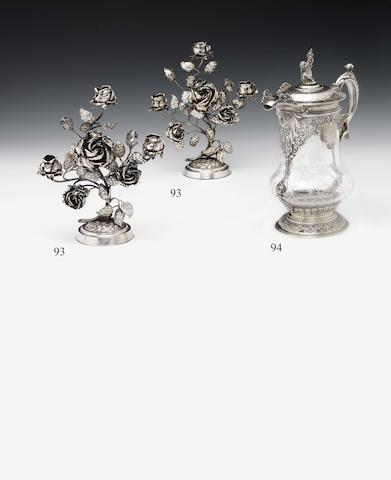 An unusual Victorian pair of silver floral three-light candelabra By Deakin and Deakin, London 1889