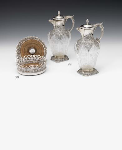 "A pair of Edwardian silver mounted and Stourbridge ""rock-crystal"" claret jugs By William Comyns, London 1901  (2)"