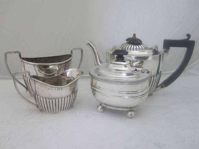 A matched three piece bachelor's silver tea service By J & R Attenborough & Co., and Minshull & Latimer, Chester and Birmingham 1900