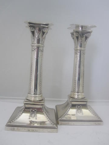A pair of silver library candlesticks Maker's mark rubbed, London 1899  (loaded)