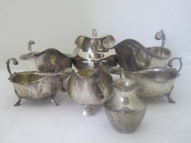 A small collection of silver sauce boats Various makers and dates  (7)