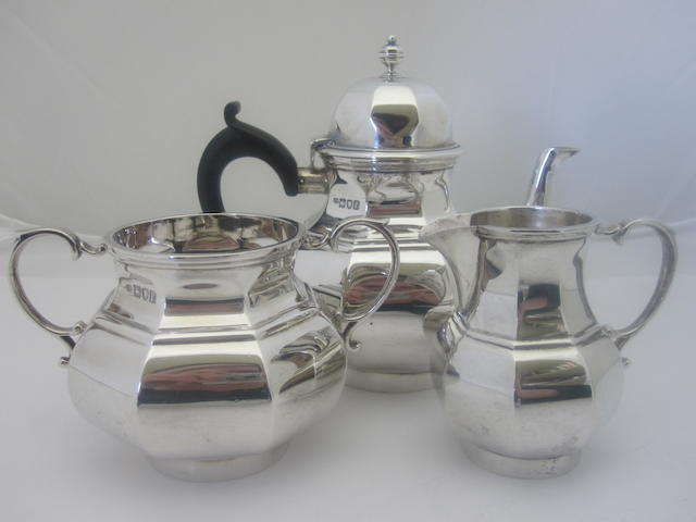 A bachelor's three piece silver tea service By J.Vickery, London 1905