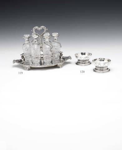 A George III silver and glass-mounted six bottle cruet stand and six spice labels By Paul Storr, the labels by Storer & Elliot, all London 1810