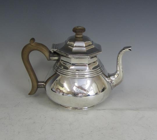 A silver octagonal-top tea pot,  by Charles and Richard Comyns, London 1922,