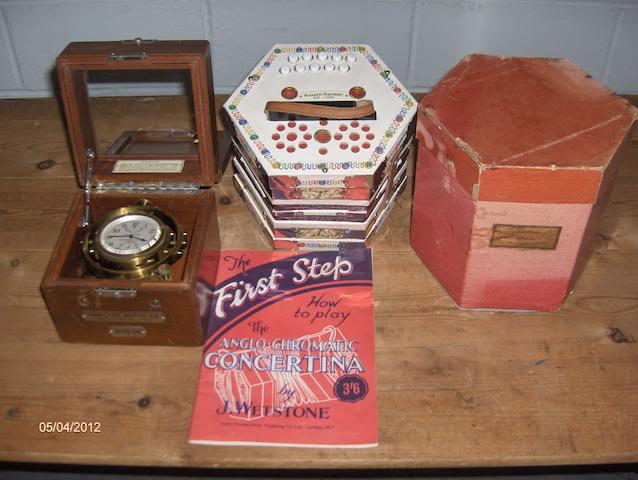 A Rossetti Rambler Delux concertina, in original box. together with a modern ship's chronometer by Walker.