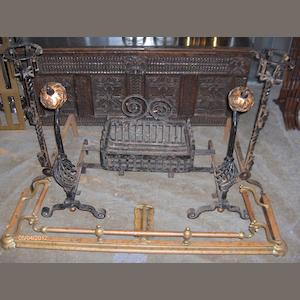 A pair of andirons and a grate