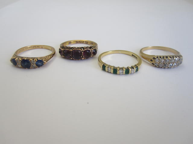 A small collection of gem-set rings (4)
