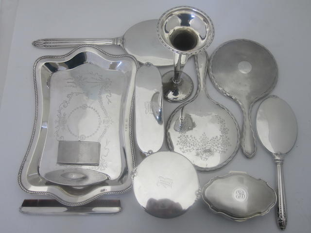 A collection of silver dressing table items