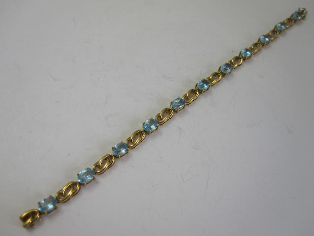 An 18ct gold blue topaz bracelet, by H. Stern