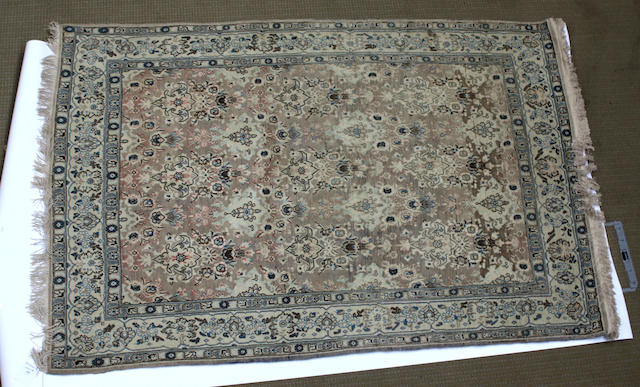 A Tabriz rug North West Persia 136cm x 200cm.