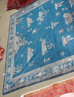A Chinese carpet 337cm x 420cm.