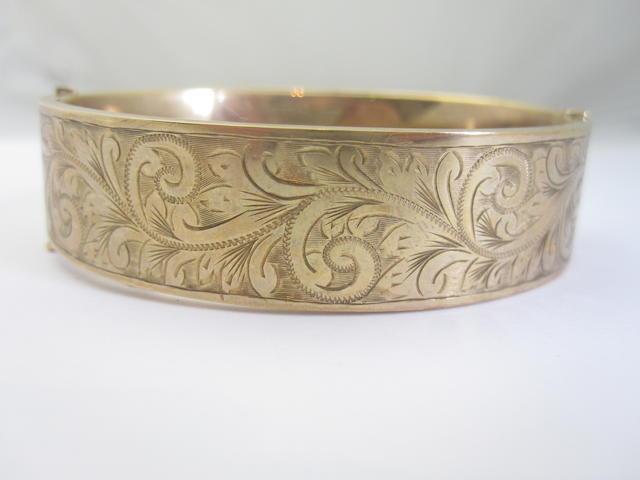 A 9ct gold bangle,