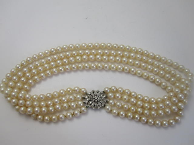 A four-row cultured pearl necklace with diamond clasp