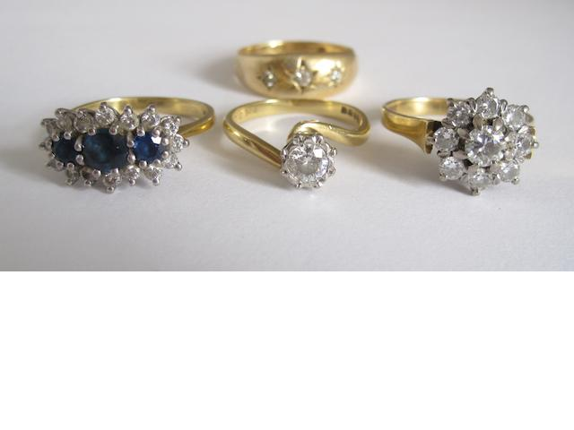 A collection of four gem-set rings