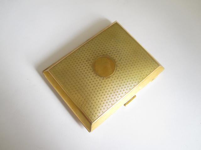 A 9ct gold cigarette case,