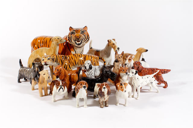 A group of eight Royal Doulton models of dogs,  two Beswick tigers,  eight beswick dogs and another one similar