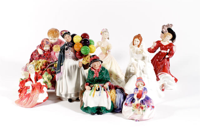 Eight Royal Doulton figures