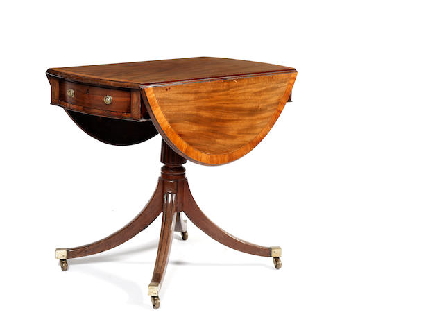 A Regency mahogany and satinwood crossbanded oval pembroke table