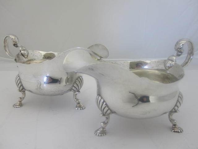 A composite pair of silver sauce boats By Mappin & Webb, London 1931 & 1933