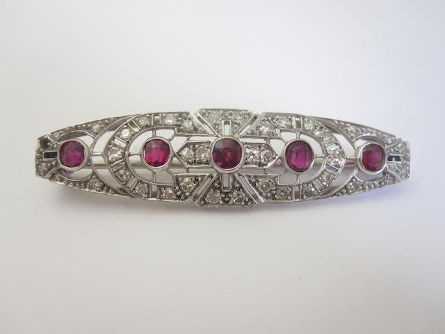 A ruby and diamond brooch, circa 1950