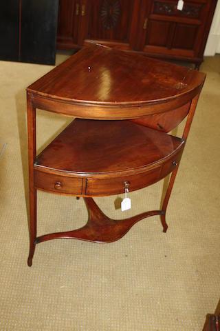 A George III mahogany corner wash stand