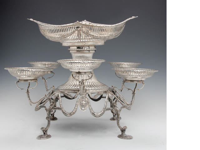 A George III silver presentation seven basket epergne by John Robins, London 1780