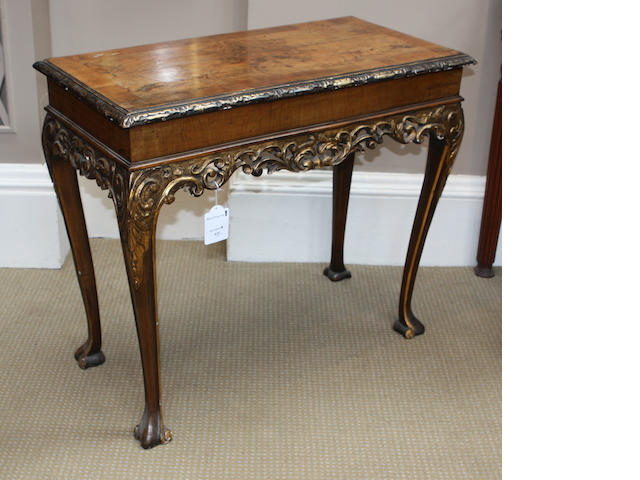 A pair of George II style walnut and parcel gilt centre tables, first quarter twentieth century