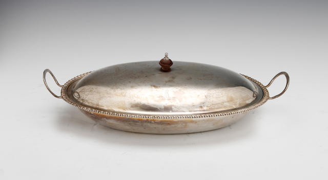 A George III oval silver two handled tureen and cover, by Augustin Le Sage,  London 1780
