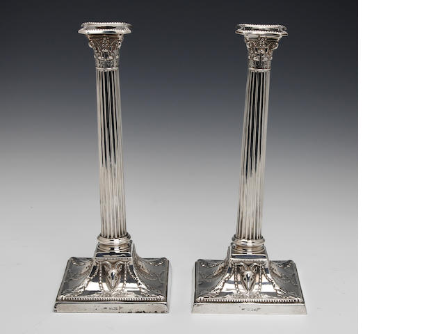 A Victorian pair of silver candlesticks, by Walker and Hall,  Sheffield 1891,