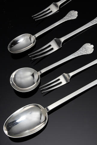 A silver canteen of trefid lacy back flatware for six place settings,  by Goldsmiths and Silversmiths Co. Ltd.,  London 1933,