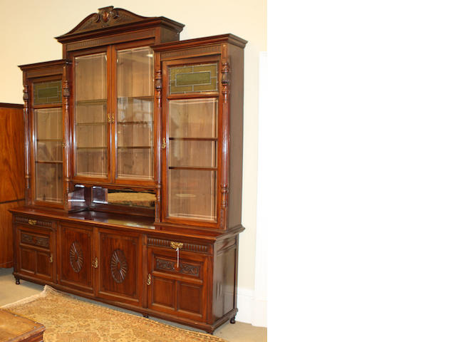 A late Victorian stained walnut cabinet bookcase