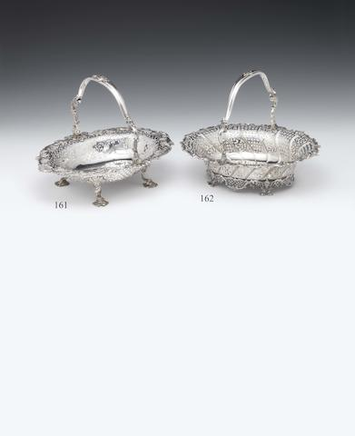 A George II silver swing-handled basket By S. Herbert & Co, London 1754