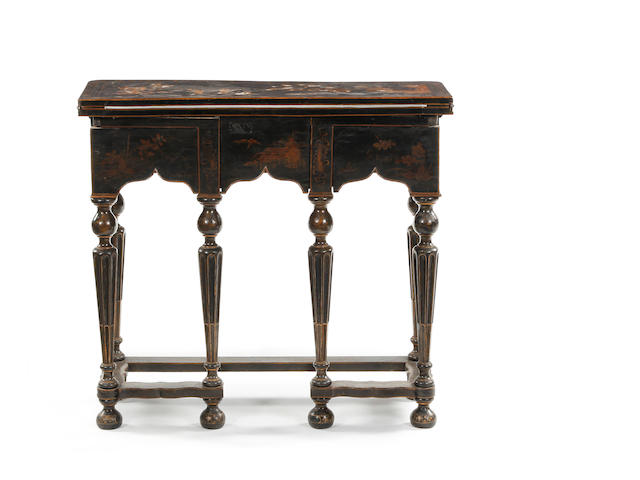 A Queen Anne black-lacquered and Chinoiserie-decorated fold-over bureau table Some elements later