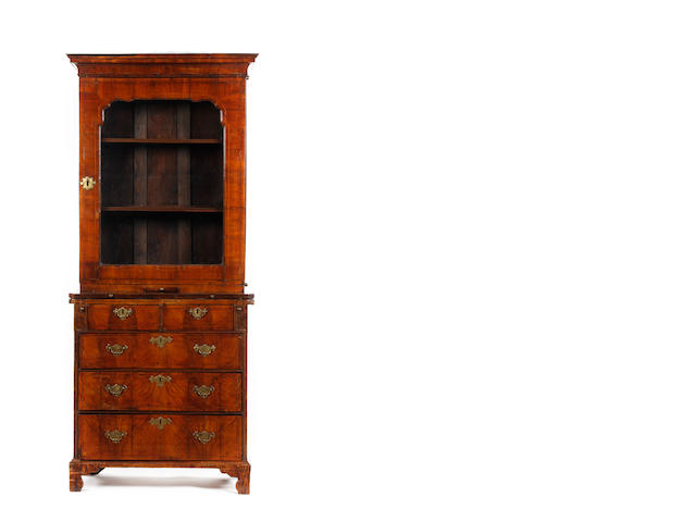 An early 18th century and later walnut and inlaid cabinet on an associated and adapted bachelor's chest