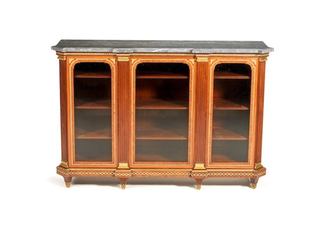A French late 19th century, Louis XVI style, ormolu-mounted kingwood, tulipwood and mahogany bibliothèque possibly by Henry Dasson, Paris