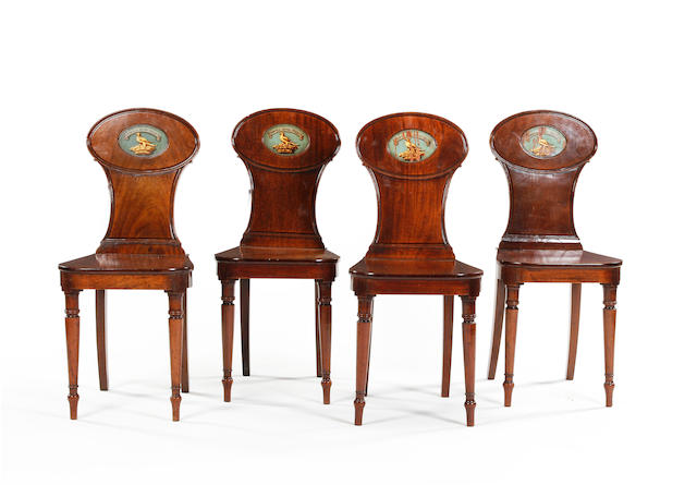 A set of four early 19th century mahogany hall chairs