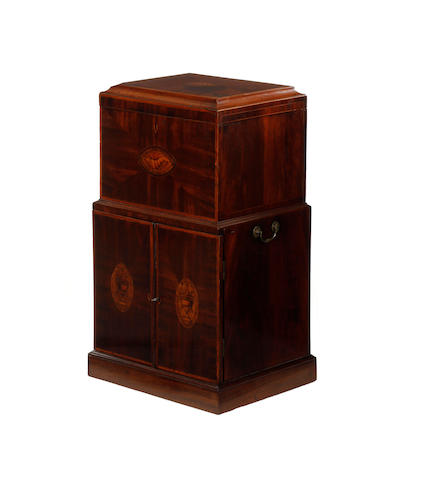 A late George III mahogany and inlaid pedestal cellaret