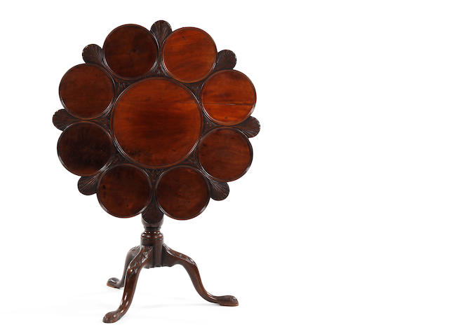 An 18th century and later carved mahogany tilt-top pedestal supper table