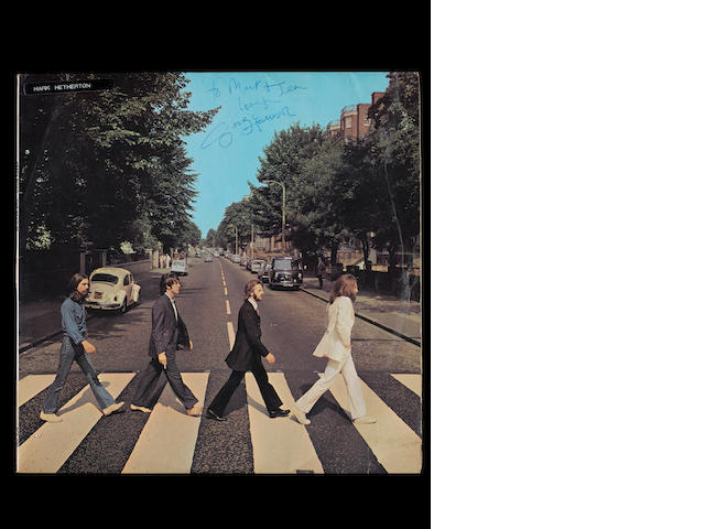 A copy of the album 'Abbey Road' autographed by George Harrison,