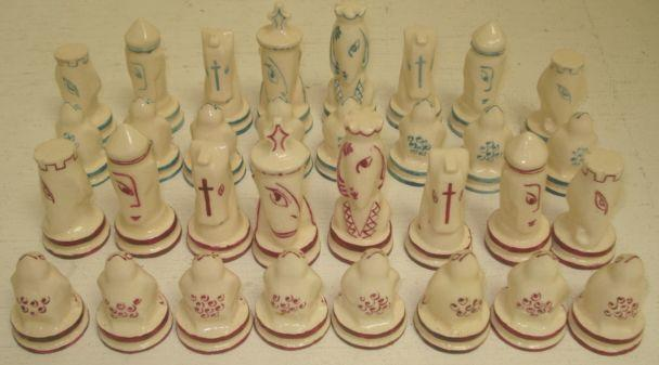 A 20th Century painted ceramic chess set, by Percy Brown (1872-1955), from the artist studio sale.