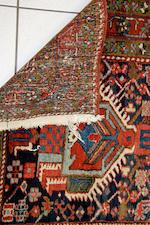 A Heriz runner, a Tekke rug and a Hamadan rug