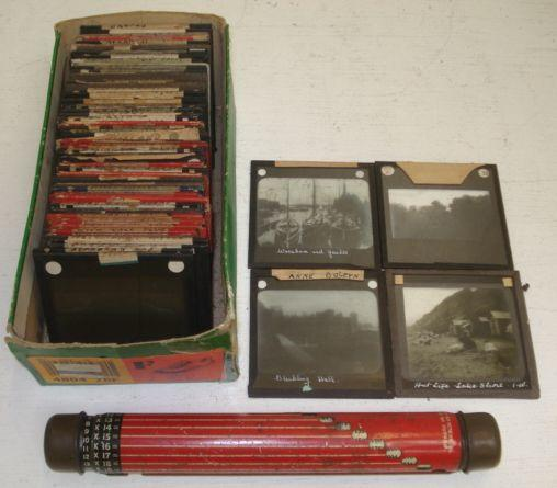 A collection of glass magic lantern slides and a Darnley's patent rotatable lighting calculator, pencil case, ruler and measure.