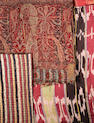 Two Kashmiri woven Shawl Fragments and an Ikat silk Panel (3) India and Uzbekistan, 18th and 20th Century(3)