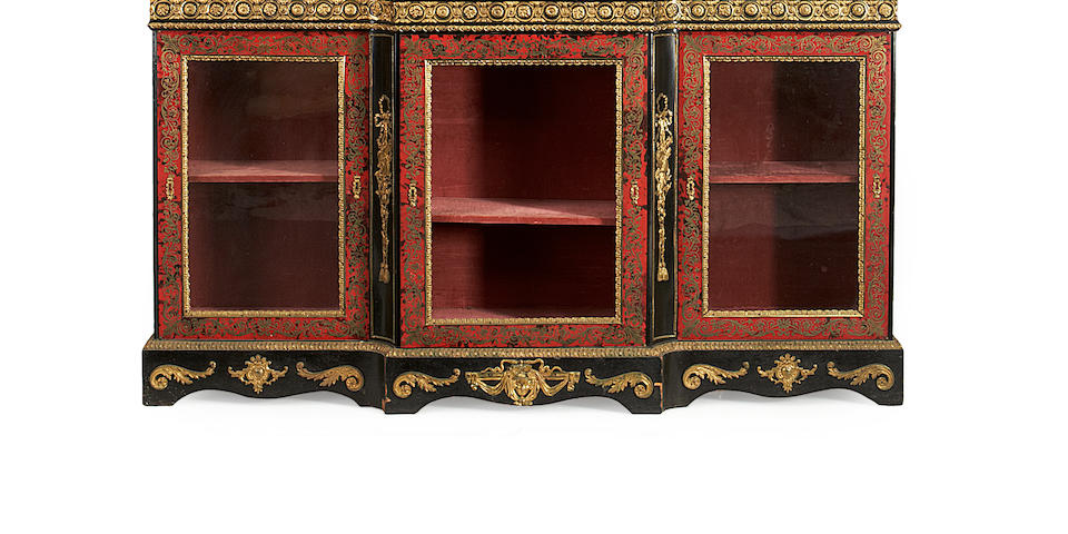A French late 19th century gilt metal mounted ebony and ebonised, stained tortoiseshell and brass 'Boulle' marquetry breakfront bookcase