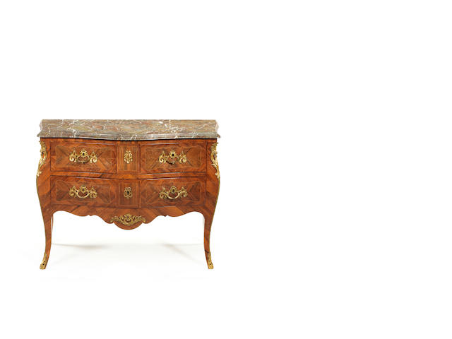 A Louis XV tulipwood, rosewood and gilt-bronze mounted commode