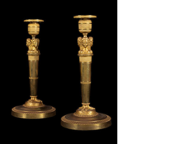A pair of chiseled & gilded bronze torchlight, caryatids patterns, Empire period