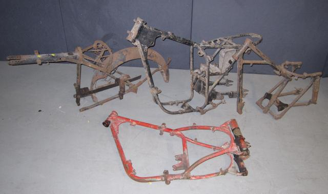 Four unidentified motorcycle frames,