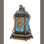 A French ormolu and champleve enamel mantel clock, 2nd half 19th Century, in the chinoiserie taste, decorated with flowering branches, on a bleu celeste ground, the arched top rectangular case surmounted by a kylin, the 8 day Japy Freres movement striking on a bell, numbered 18595 and stamped 'Miller & Sons', 50cm high.