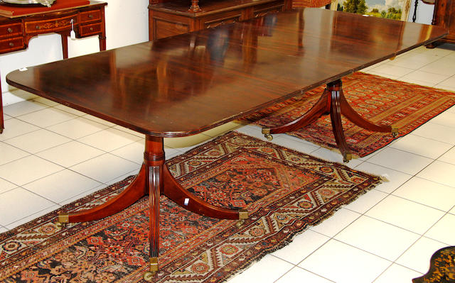 A mahogany twin pillar D-end dining table in the Regency manner