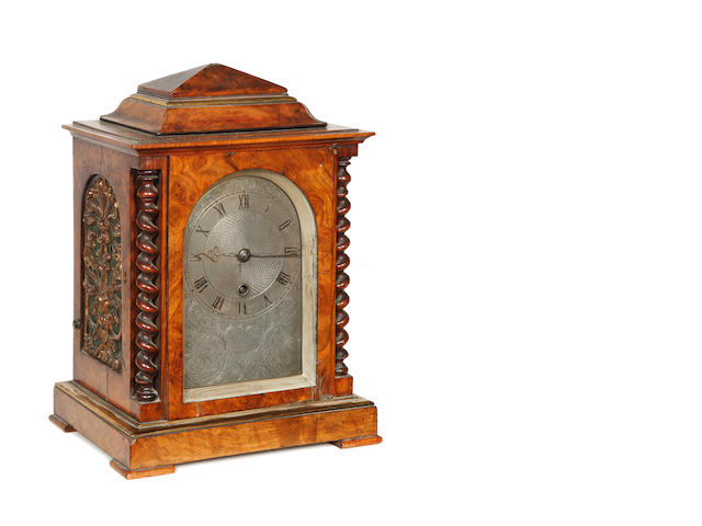 A mid-19th Century walnut mantel timepiece